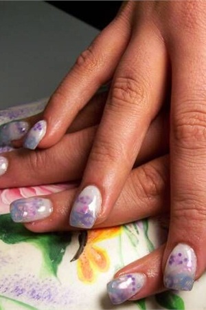 Students at TW Nail Technology Inc. can practice their skills on local customers, who opt to receive the service at a discounted price.