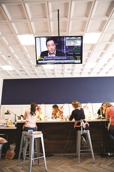 A manicure bar sits at the center of the salon, encouraging social interaction.