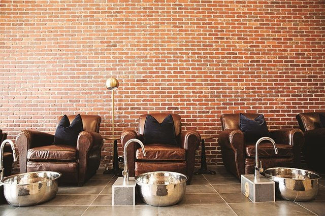 Salon owner Nina Babaie chose large leather chairs so male clients could be comfortable visiting for a pedicure in her salon.