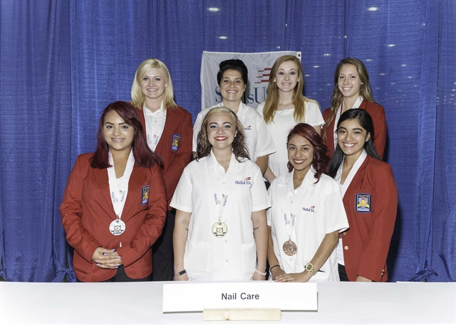 The 2015 Nail Care Technology Medalists: Front row L to R: High School medalists Silver Medalist-Natalie Carmona-Garcia, Metro Career & Tech Center (Ark.); Gold Medalist-Alex Stapleton, Sullivan Central High School (Tenn.); and Bronze Medalist- Cynthia Gonzales. Also pictured is nail model Yvette Jimenez Back row L to R: College/Postsecondary Silver Medalist-Amy Sayler, Lorain County JVS (Ohio); Gold Medalist-Briana Knackstedt, Kaskaskia College (Ill.); nail model Kayla Brown, and Bronze Medalist-Cassidy Bell, Tennessee College of Applied Technology Chattanooga (Tenn.)