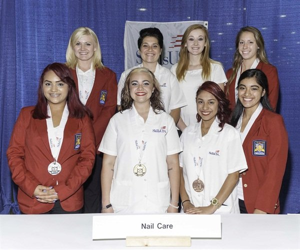 Front row L to R: High School medalists Silver Medalist-Natalie Carmona-Garcia, Metro Career & Tech Center (Ark.); Gold Medalist-Alex Stapleton, Sullivan Central High School (Tenn.); and Bronze Medalist- Cynthia Gonzales. Also pictured is nail model Yvette Jimenez Back row L to R: College/Postsecondary Silver Medalist-Amy Sayler, Lorain County JVS (Ohio); Gold Medalist-Briana Knackstedt, Kaskaskia College (Ill.); nail model Kayla Brown, and Bronze Medalist-Cassidy Bell, Tennessee College of Applied Technology Chattanooga (Tenn.)