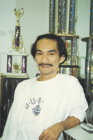 <p>Trang, in 1997, flanked by a few of him many competition photos.</p>
