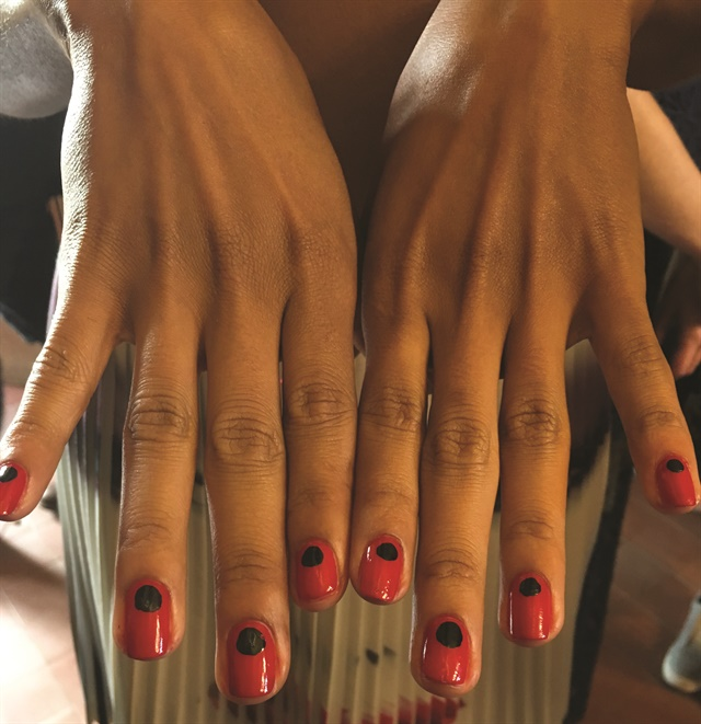 This NYFW-inspired design by OPI nail artists shows how to mix bold and neutral color for a strong, graphic design.