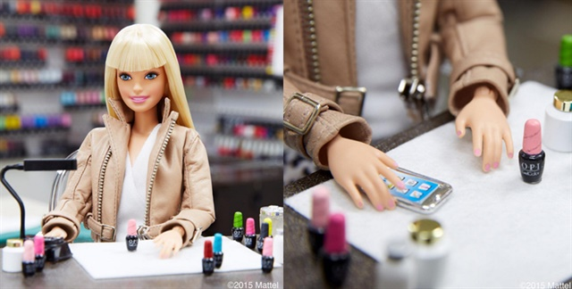 <p>Barbie takes a trip to the OPI headquarters for a GelColor manicure.</p>