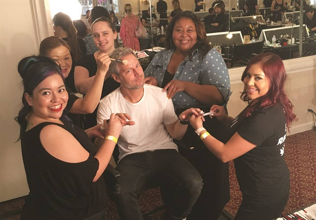 <p>Bachik (center) and the OPI manicuring team behind the scenes.</p>