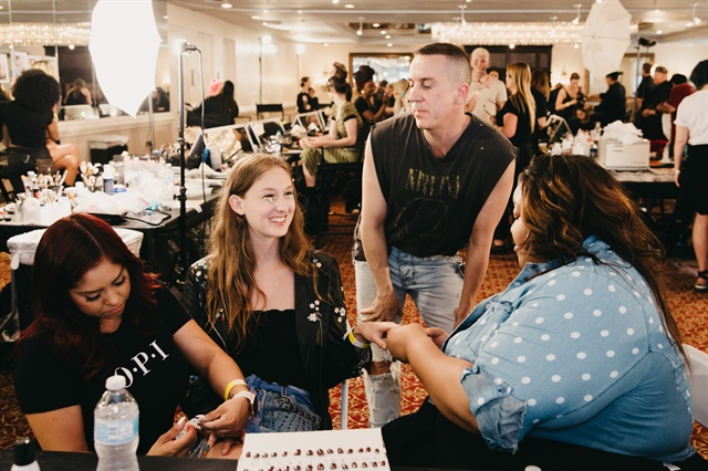 <p>Jeremy Scott oversees the nail application</p>