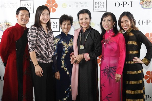 "Members of the Vietnamese nail industry celebrated in the event — Advance Beauty College owners Tam Nguyen (left) and Linh Nguyen (far right), NAILS and VietSALON senior editor Kim Pham, Advance Beauty College founder Kien Tam Nguyen, Vietnamese-American actress Kieu Chinh, and Thuan Le, one of the ""Original 20."""