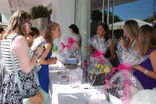 Great gift baskets filled with beauty products were displayed in the festive outdoor courtyard.