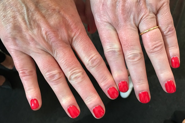 Suzi wore Coca Cola Red from OPI's collab with Coca Cola