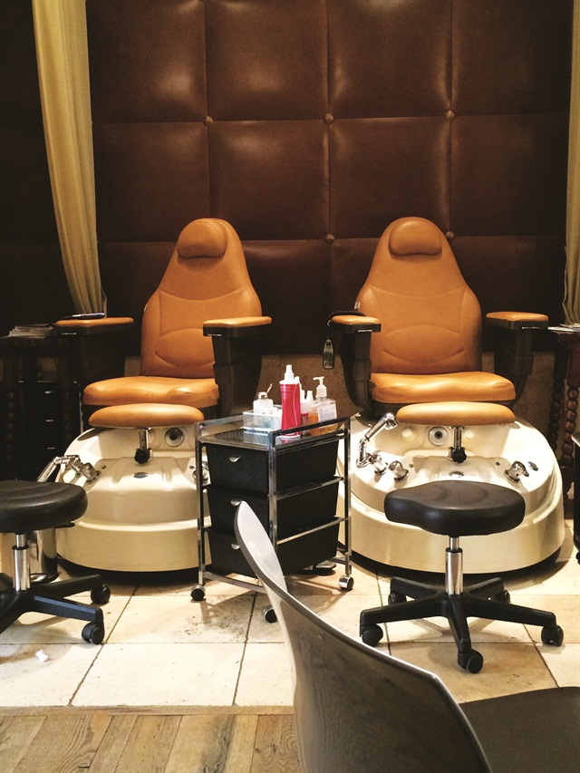 <p>Five pedicure stations line the wall of the nail area. Six nail techs work at the spa and many service local regulars, not just tourists.</p>