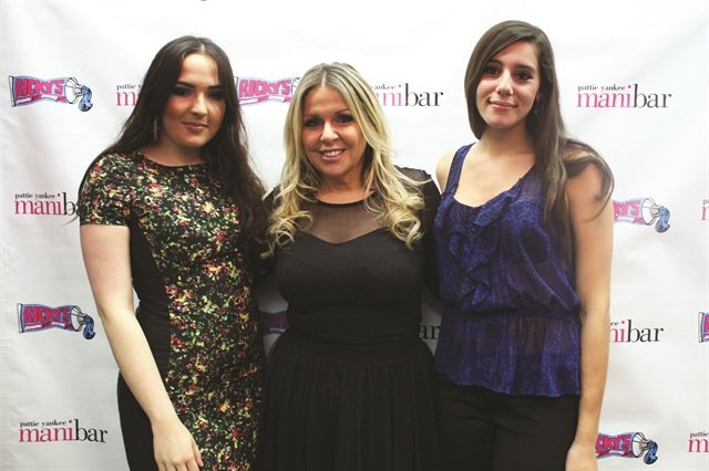 <p>Nail tech Pattie Yankee (center) at her mani bar opening in New York City.</p>