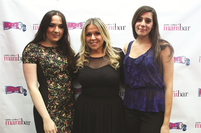 Nail tech Pattie Yankee (center) at her mani bar opening in New York City.