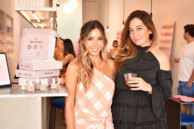 Blogger Sivan Ayla, left, and NCLA founder Elin Dannerstedt, right, at their polish preview party in Los Angeles.