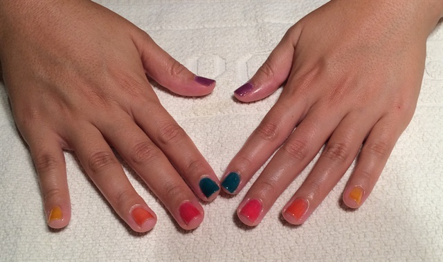 <p>Travel gave me a multi-hued manicure using Essie Watercolors.</p>