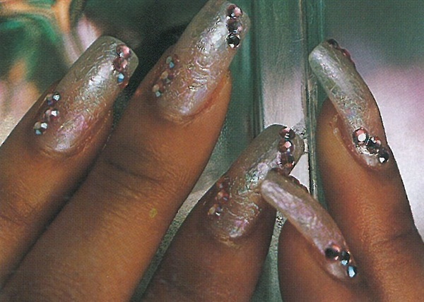 <p>Brian Klaus uses soft background lights to lightlight the nail art. </p>