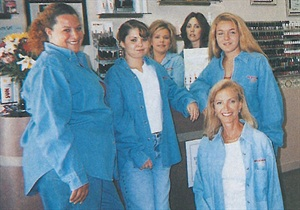 <p>Awesome Nails owner Mary Metscaviz (bottom row, seated) says she and her staff are so close they even enter nail competitions together.</p>