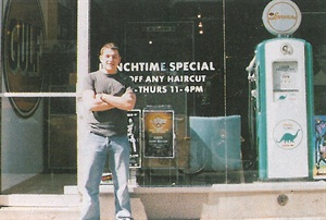 <p><span>Tanchuk stands near the entrance to The Service Station, a mostly male salon that is decorated with old-fashioned Gulf and Mobile gasoline signs and an antique pump.</span></p>