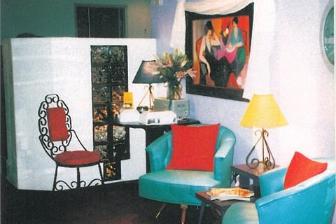 <p>Inside Nail Designs, the feeling is one of eclectic comfort. The waiting area cost a total of $100 to furnish, since Tye found most of her pieces at yard sales.</p>