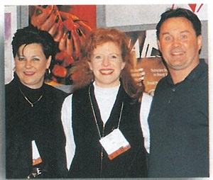 <p>Debbie Krakalovich (left) Recipient of the 1997 IBS Editors' Choice Award as Most Newsworthy Nail Artist. Here she is with NAILS editor Cyndy Drummey and her husband (far right).</p>