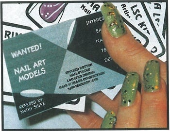 <p>Kitsko's nail art model passes out special cards to would be clients. </p>