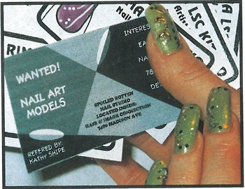 <p>Kitsko's nail art model passes out special cards to would be clients.</p>