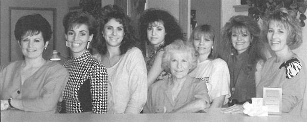 <p>Cindy Fairchild (far right) poses with Fancy Fingers N' Toes employees.</p>