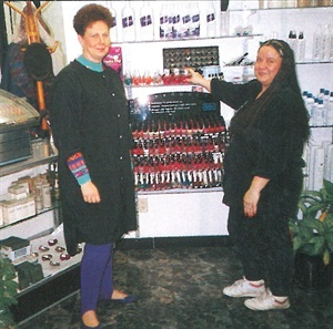 <p>Connie Lockwood (left), owner of Trendi's in Flint, Mich., and Sandra Lee Kipp show off Trendi's display of polish. </p>