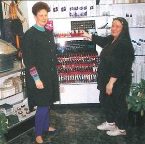 <p>Connie Lockwood (left), owner of Trendi's in Flint, Mich., and Sandra Lee Kipp show off Trendi's display of polish.</p>