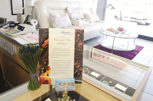 <p>The $35 Chocolate Pedicure Special is prominently displayed in the retail area. It includes champagne, a chocolate foot soak, and a chocolate buttercream massage.</p>