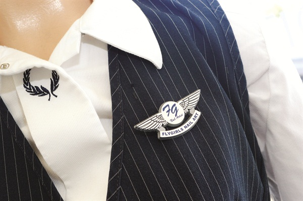 """""""Betty"""" wears her Fly Girls wings with pride."""
