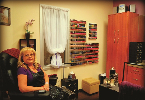 <p>Cindy Schmidt of Cindy's place relaxes in her Phoenix Sola Salon Studio.</p>