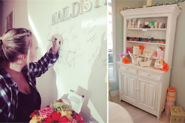 Guests sign the wall at Nail District, a fun interactive touch. Retail items are attractively displayed in freestanding pieces like this whitewashed hutch.