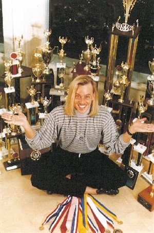 Tom Holcomb with competition trophies, 1990.