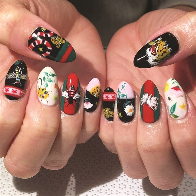 <p>Vanity Projects nail artists often look at fashion trends to influence their manicures, like in this Gucci print design.</p>