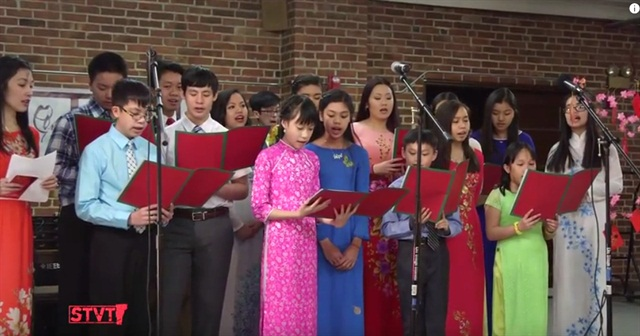 Students sing the South Vietnamese national anthem during the Lunar New Year celebration in Burlington, Vt.