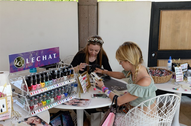 LeChat educator Anastasiia Morozova gives Victoria Monfort a festival mani.