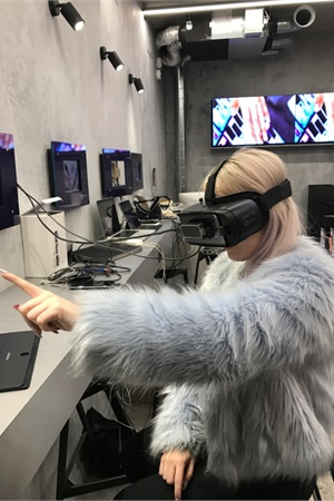 A customer tests out the Virtual Reality Nail Designer at WAH Soho Nail Salon in London.