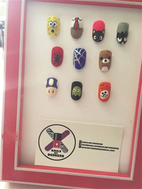 <p>Desreen's (@nailsbydesreen) menu featured Spongebob and Sanrio characters.</p>