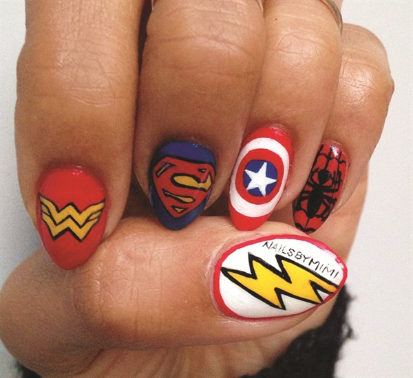 <p>Mimi (@nailsbymimi) shows off her own superhero nails.</p>
