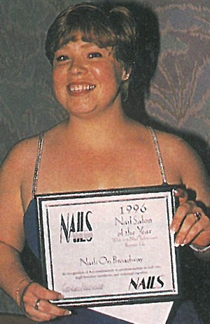 <p>Nails on Broadway owner Leslyn Zak gleefully accepts her runner-up award for Nail Salon of the Year with 1-3 Nail Technicians. </p>