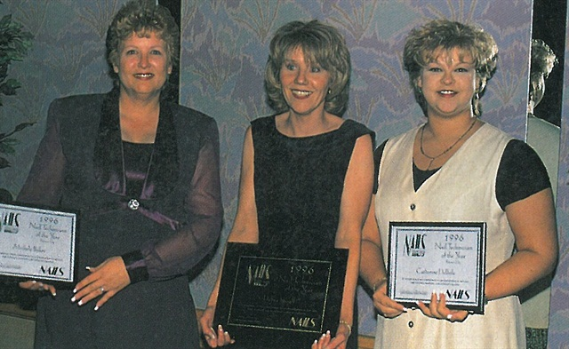 <p>Runners up for Nail Technician of the Year Catherine DePoole (right) and Michele Baker (left) flank Nail Technician of the Year Debra Shoaff in the winner's circle. </p>