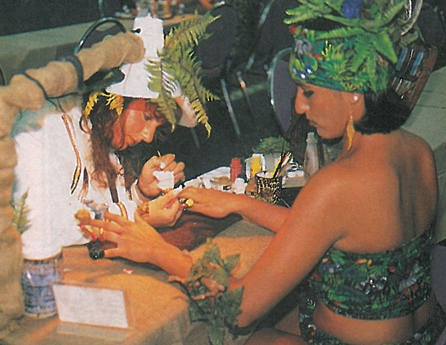 """<p>This fantasy nail art competitor got so into the """"Jungle Fever"""" theme that not only was her model costumed as required,she decorated hertable area too.</p>"""