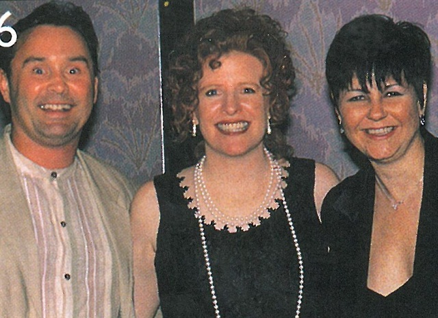 <p>Both Debbie (right) and Gary Krakalovich went home from the awards ceremony with their hands full -- each of their salons won first place in the Nail Salon of the Year contest, one tied for first in the 1-3 technicians category while the other won hands-down the 4-7 technicians category.</p>