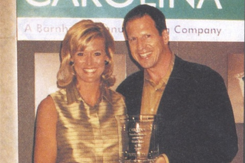 Carolina's Kristel Dean presents Nailco's present Larry Gaynor with the 1997-98 DIstributor of the Year Award.