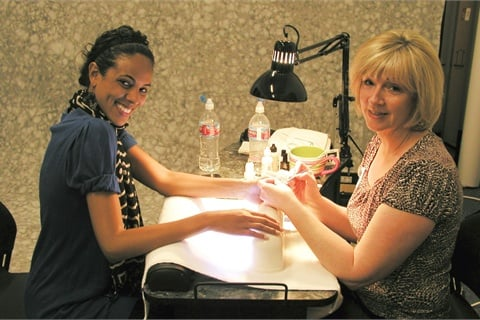 <p>Nail tech June Sierra (right) drove out to Los Angeles from the Palm  Springs area to do a full set of gel fingernails and gel toenails on  this month's cover model, Ariel.</p>