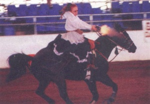 <p>When she's not in the salon or teaching compute classes, nail technician Tricia McMaster can often be found astride her horse participating in cowboy mounted shooting competitions.</p>