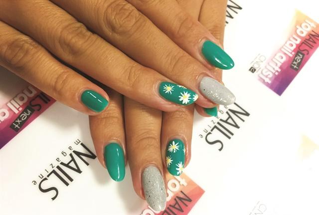 <p>Daisy nail art done by Megan Balouchi using gel-polish for the Nail Tech Event of the Smokies.</p>