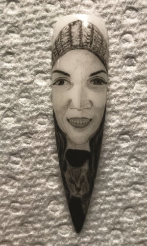 <p>A huge milestone for me was getting my portrait painted on a nail. Artwork by Long Do.</p>