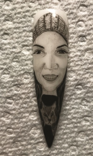 A huge milestone for me was getting my portrait painted on a nail. Artwork by Long Do.