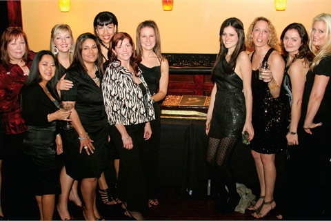 <p>Some Entity employees and educators take a break from the dance floor to pose for this shot.</p>
